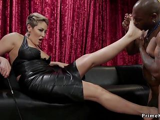 A white mistress having fun with her black slave